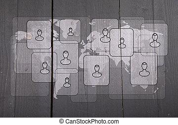 Illustration of people on white world map on dark black wooden background
