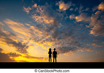 silhouette of the couple at sunset