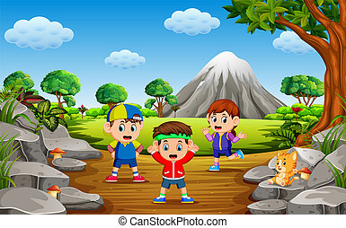 the children do sport in the forest near the rock mountain with a lot of trees