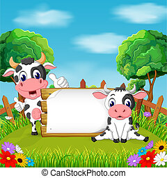 the nature view with the wooden board blank space and two cow holding it