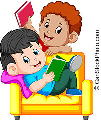 Two boy is reading book sitting on a big comfy chair -...