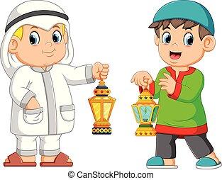 Two Moslem man holding lantern