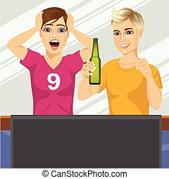 two young friends watching sports game