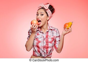 I'm choosing apple. Sexy young pin-up girl holding a pear in...