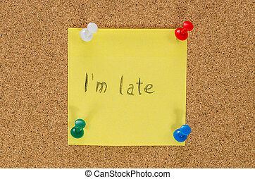 I'm late note pinned on the cork board
