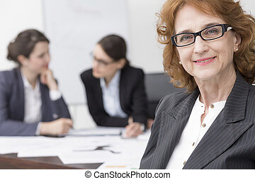 I'm proud of my business team - Mature businesswoman with...