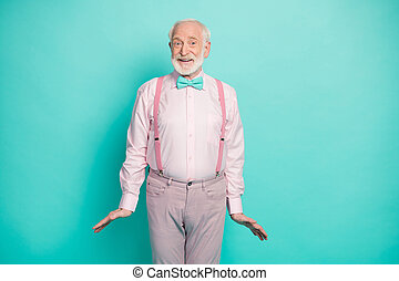 I'm ready. Photo of funny grandpa good mood listen cool news black friday season addicted shopper wear pink shirt suspenders bow tie pants isolated teal color background