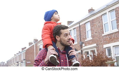I'm the king of the castle! - Young father carrying his son...