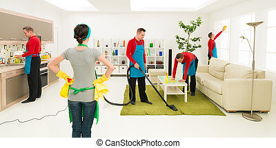 man cleans house in different places at the same time while woman supervise progress