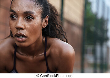 Image closeup of athletic african american woman standing outdoors