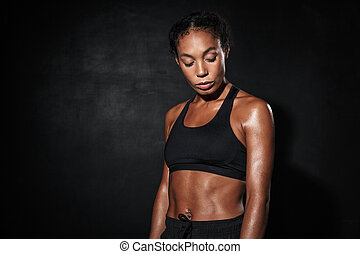 Image closeup of serious african american woman in sportswear