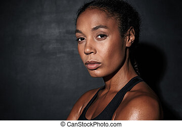 Image closeup of young african american woman in sportswear