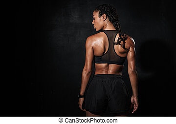 Image from back of athletic african american woman in sportswear
