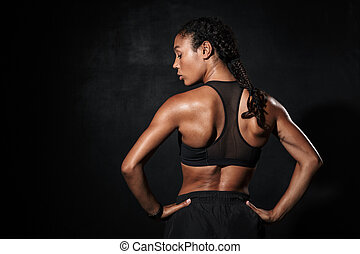 Image from back of slim african american woman in sportswear