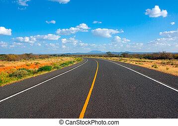 Image of a asphalt road in the African savannah
