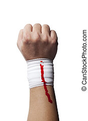 bandage on a human hand with blood on it