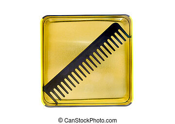 black comb in a yellow tin box on a white background