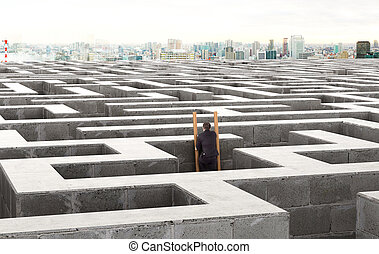Image of a businessman standing on the stairs in a labyrinth. 3d illustration