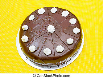 chocolate cake on yellow background