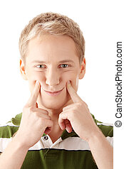 Image of a cute young male with fake smile