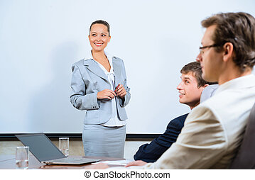 discusses business woman with colleagues