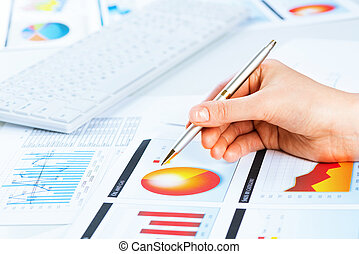 female hand pointing to the financial growth chart