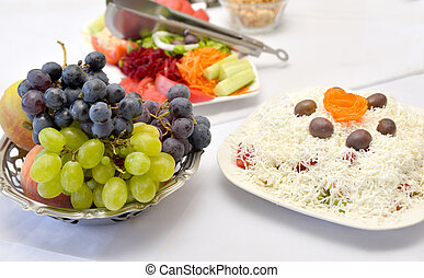 grape ans salad on a restaurant table
