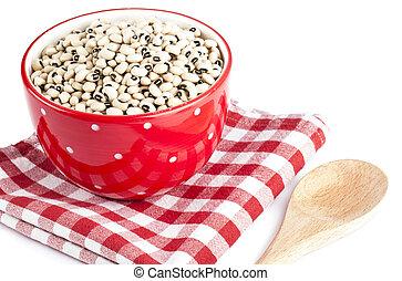 red bowl full of black eye beans