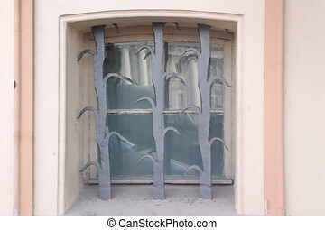 Image of a window in an old building with original protection