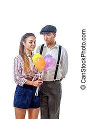 young man in a cap gave the girl balloons