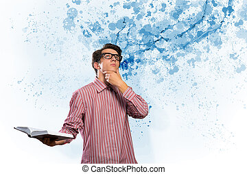 creative mind - image of a young man with a book, a creative...