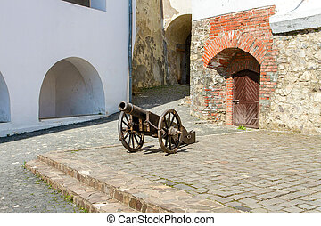old cannon in the courtyard of Palanok castle in the city of Mukachevo Ukraine