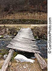 old wood bridge over creek