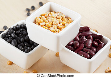 arrangement of assorted beans on a white bowl