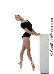 Image of artistic ballerina dancing in studio