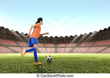 Image of asian female footballer kicking the ball