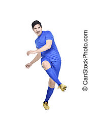 Image of asian football player man with blue jersey in action