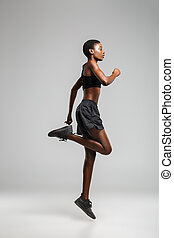 Image of athletic african american woman doing exercise