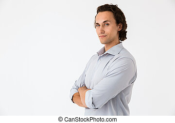 Image of attractive businessman in office shirt looking at camera