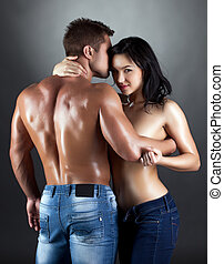 Image of attractive lovers embracing in studio