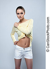 Image of attractive young model posing in studio
