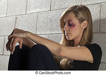 battered young woman - Image of battered young woman sitting...