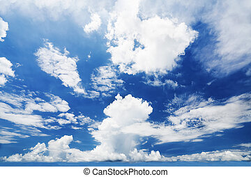 blue sunny sky with clouds