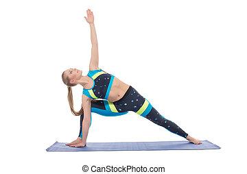 Image of beautiful female athlete warming up