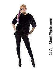 Image of blonde in black jacket, hands on hips