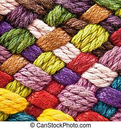 image of braided multi colored woollen yarns