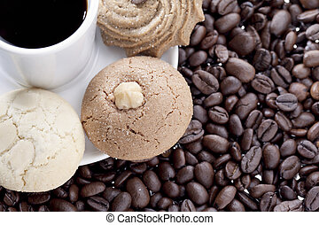 brew coffee and assorted cookies in a white plate