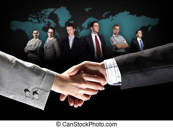 image of business handshake - business handshake against...
