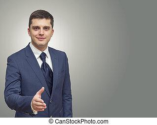 businessman extending hand to shake