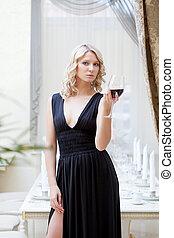 Image of charming woman in elegant black dress